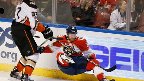 Anaheim Ducks left wing Nick Ritchie (37) slams Florida Panthers defenseman Mike Matheson (19) into the boards during the second period of an NHL hockey game, Thursday, Oct. 26, 2017 in Sunrise, Fla. (AP Photo/Wilfredo Lee)