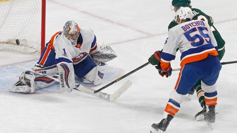Minnesota Wild's Eric Staal, right, scores a short-handed goal against New York Islanders goalie Thomas Greiss, of Germany, during the first period of an NHL hockey game Thursday, Oct. 26, 2017, in St. Paul. Minn. (AP Photo/Jim Mone)