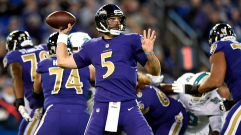 Baltimore Ravens quarterback Joe Flacco (5) throws to a receiver in the first half of an NFL football game against the Miami Dolphins, Thursday, Oct. 26, 2017, in Baltimore. (AP Photo/Gail Burton)