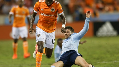 Sporting Kansas City midfielder Ilie Sanchez (6) successfully tackles Houston Dynamo forward Alberth Elis (17) during the first half of an MLS soccer playoff game, Thursday, Oct. 26, 2017 in Houston. ( Yi-Chin Lee/Houston Chronicle via AP)