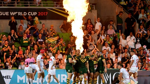 Australian players celebrate a goal against England during their Rugby League World Cup game in Melbourne, Australia, Friday, Oct. 27, 2017. (AP Photo/Andy Brownbill)