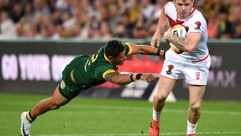 England's John Bateman, right, gets away from Australia's Dane Gagai, left, during their Rugby League World Cup game in Melbourne, Australia, Friday, Oct. 27, 2017. (AP Photo/Andy Brownbill)
