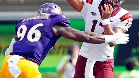 File-This Sept. 16, 2017, file photo shows Virginia Tech's Josh Jackson (17) trying to throw a pass while being rushed by East Carolina's Kiante Anderson (96) during the first half of an NCAA college football game in Greenville, N.C. Jackson's efficiency remains a huge party of the Virginia Teach's success. He's thrown 16 touchdown passes with your four interceptions and is completing 64.2 percent of his passes. Jackson also is third on the team is rushing with 173 yards. (AP Photo/Karl B DeBlaker, File)