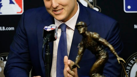 Chicago Cubs first baseman Anthony Rizzo talks to the media after winning the 2017 Roberto Clemente Award before Game 3 of baseball's World Series between the Los Angeles Dodgers and the Houston Astros Friday, Oct. 27, 2017, in Houston. (AP Photo/Chris Carlson)