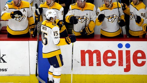 Nashville Predators right wing Craig Smith (15) celebrates with teammates after scoring a goal against the Chicago Blackhawks during the second period of an NHL hockey game Friday, Oct. 27, 2017, in Chicago. (AP Photo/Nam Y. Huh)