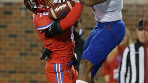 Tulsa wide receiver Josh Stewart (1) and SMU defensive back Jordan Wyatt (15) go up for a pass during the first half of an NCAA college football game in Dallas, Friday, Oct. 27, 2017. Pass interference was called on Tulsa's Wyatt on the play. (AP Photo/LM Otero)