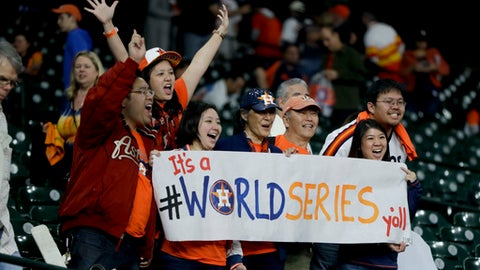 Houston Astros fans celebrate after there win against the Los Angeles Dodgers during Game 3 of baseball's World Series Friday, Oct. 27, 2017, in Houston. The Astros won 5-3 to take a 2-1 lead in the series. (AP Photo/Charlie Riedel)