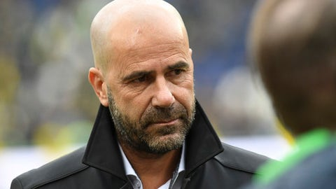 Dortmund's coach Peter Bosz arrives ahead of the Bundesliga soccer match between Hannover 96 and Borussia Dortmund in the HDI Arena in Hannover, Germany, Saturday, Oct. 28, 2017.  (Peter Steffen/dpa via AP)