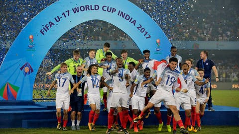 England's team members celebrate during the presentation ceremony after winning the the FIFA U-17 World Cup trophy in Kolkata, India, Saturday, Oct. 28, 2017. (AP Photo/Anupam Nath)