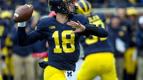 Michigan quarterback Brandon Peters (18) throws a pass in the second quarter of an NCAA college football game in Ann Arbor, Mich., Saturday, Oct. 28, 2017. (AP Photo/Tony Ding)
