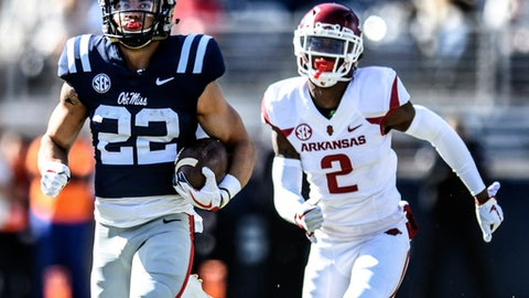 Mississippi running back Jordan Wilkins (22) outruns Arkansas defensive back Kamren Curl (2) to scores a touchdown during an NCAA college football game at Vaught-Hemingway Stadium in Oxford, Miss., Saturday, Oct. 28, 2017. (Bruce Newman/The Oxford Eagle via AP)