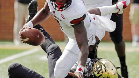 Louisville's Lamar Jackson (8) is sacked by Wake Forest's Duke Ejiofor (53) during the first half of an NCAA college football game in Winston-Salem, N.C., Saturday, Oct. 28, 2017. (AP Photo/Chuck Burton)