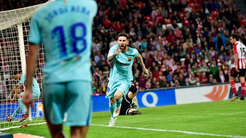 FC Barcelona's Lionel Messi, center, celebrates after scoring against Athletic Bilbao during the Spanish La Liga soccer match between Athletic Bilbao and FC Barcelona, at San Mames stadium, in Bilbao, northern Spain, Saturday, Oct. 28, 2017. (AP Photo/Alvaro Barrientos)