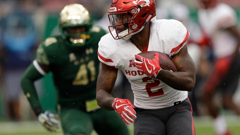 Houston running back Duke Catalon (2) runs past South Florida defensive end Greg Reaves (41) during the first half of an NCAA college football game, Saturday, Oct. 28, 2017, in Tampa, Fla. (AP Photo/Chris O'Meara)