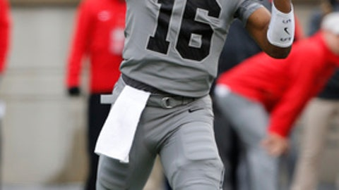 Ohio State quarterback J.T. Barrett throws a pass against Penn State during the first half of an NCAA college football game Saturday, Oct. 28, 2017, in Columbus, Ohio. (AP Photo/Jay LaPrete)