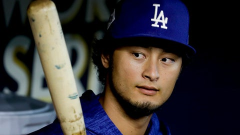 Los Angeles Dodgers starting pitcher Yu Darvish, of Japan, watches batting practice before Game 4 of baseball's World Series Houston Astros Saturday, Oct. 28, 2017, in Houston. (AP Photo/Matt Slocum)
