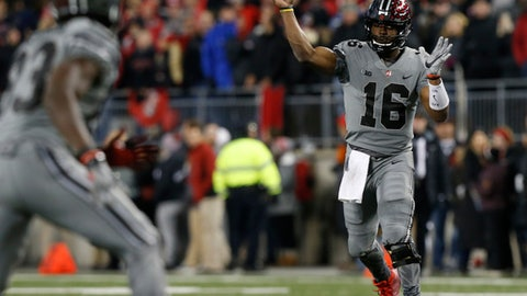 Ohio State quarterback J.T. Barrett throws a pass against Penn State during the second half of an NCAA college football game, Saturday, Oct. 28, 2017, in Columbus, Ohio. Ohio State defeated Penn State 39-38. (AP Photo/Jay LaPrete)