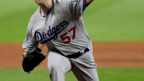 Los Angeles Dodgers starting pitcher Alex Wood throws against the Houston Astros during the first inning of Game 4 of baseball's World Series Saturday, Oct. 28, 2017, in Houston. (AP Photo/Matt Slocum)