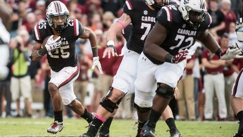 South Carolina running back A.J. Turner (25) carries the ball around a block from lineman Donell Stanley (72) during the first half of an NCAA college football game against Vanderbilt, Saturday, Oct. 28, 2017, in Columbia, S.C. (AP Photo/Sean Rayford)