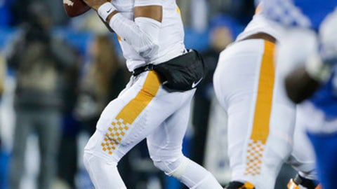 Tennessee quarterback Jarrett Guarantano looks for a receiver during the first half of an NCAA college football game against Kentucky Saturday, Oct. 28, 2017, in Lexington, Ky. (AP Photo/David Stephenson)