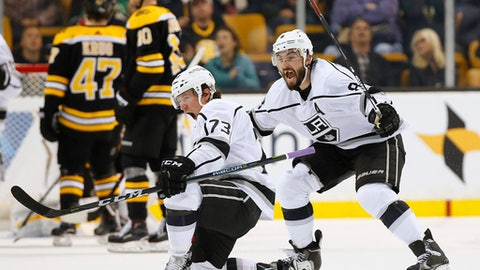 Los Angeles Kings' Tyler Toffoli (73) celebrates his goal in the overtime period with teammate Drew Doughty to defeat the Boston Bruins 2-1 in an NHL hockey game in Boston, Saturday, Oct. 28, 2017. (AP Photo/Winslow Townson)