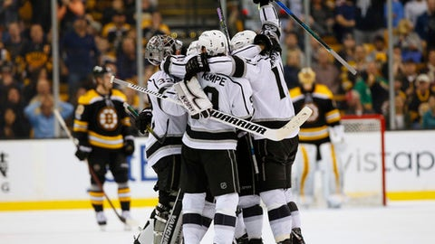 The Los Angeles Kings celebrate after Tyler Toffoli scored with no time left in the overtime period to defeat the Boston Bruins 2-1 in an NHL hockey game in Boston, Saturday, Oct. 28, 2017. (AP Photo/Winslow Townson)