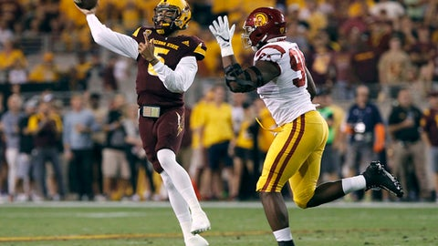 Arizona State quarterback Manny Wilkins (5) throws a pass as he is pressured by Southern California defensive lineman Rasheem Green (94) during the first half of an NCAA college football game, Saturday, Oct. 28, 2017, in Tempe, Ariz. (AP Photo/Ralph Freso)