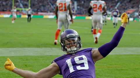 Minnesota Vikings wide receiver Adam Thielen (19) celebrates after catching an 18-yard touchdown pass as Cleveland Browns' Jamar Taylor (21) and Ibraheim Campbell (24) walk in the background during the first half of an NFL football game at Twickenham Stadium in London, Sunday Oct. 29, 2017. (AP Photo/Matt Dunham)