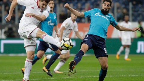 Lokomotiv's Taras Mykhalyk, left, fights for the ball with Zenit's Miha Mevlja during a Russia's Premier League soccer match between Zenit St. Petersburg and Lokomotiv Moscow in St. Petersburg, Russia, Sunday, Oct. 29, 2017. (AP Photo/Dmitri Lovetsky)
