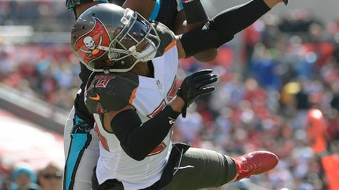 Tampa Bay Buccaneers cornerback Vernon Hargreaves III (28) breaks up a pass intended for Carolina Panthers wide receiver Devin Funchess (17) during the first quarter of an NFL football game Sunday, Oct. 29, 2017, in Tampa, Fla. (AP Photo/Phelan Ebenhack)