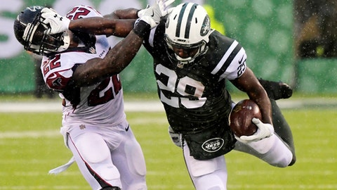 New York Jets' Bilal Powell (29) stiff-arms Atlanta Falcons' Keanu Neal (22) during the first half of an NFL football game, Sunday, Oct. 29, 2017, in East Rutherford, N.J. (AP Photo/Bill Kostroun)