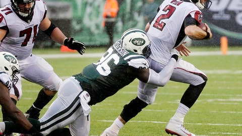 New York Jets defensive end Muhammad Wilkerson (96) sacks Atlanta Falcons quarterback Matt Ryan (2) during the first half of an NFL football game, Sunday, Oct. 29, 2017, in East Rutherford, N.J. (AP Photo/Seth Wenig)
