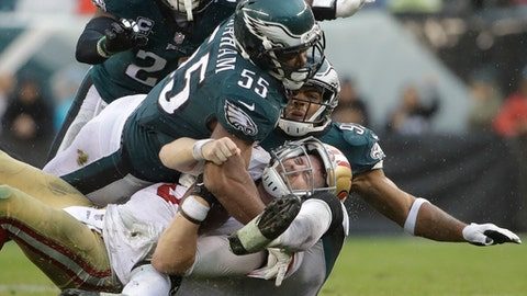 San Francisco 49ers' C.J. Beathard (3) is sacked by Philadelphia Eagles' Brandon Graham (55) and Mychal Kendricks (95) during the second half of an NFL football game, Sunday, Oct. 29, 2017, in Philadelphia,. (AP Photo/Michael Perez)