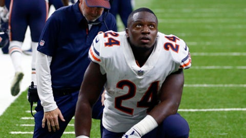 Chicago Bears running back Jordan Howard (24) and head coach John Fox, behind, kneel in sympathy for injured Bears tight end Zach Miller, in the second half of an NFL football game against the New Orleans Saints in New Orleans, Sunday, Oct. 29, 2017. Miller hurt his leg on an apparent touchdown reception that was overturned on review. (AP Photo/Butch Dill)