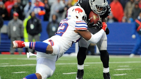 Buffalo Bills defensive back Colt Anderson, right, scores on a touchdown pass form quarterback Derek Carr, not pictured, as Buffalo Bills middle linebacker Preston Brown (52) tries to stop him during the second half of an NFL football game, Sunday, Oct. 29, 2017, in Orchard Park, N.J. (AP Photo/Adrian Kraus)