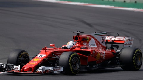 Ferrari driver Sebastian Vettel, of Germany, steers his car during the Formula One Mexico Grand Prix auto race at the Hermanos Rodriguez racetrack in Mexico City, Sunday, Oct. 29, 2017. (AP Photo/Rebecca Blackwell)