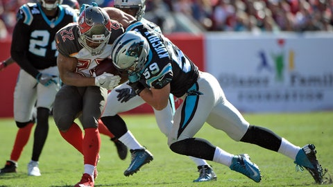 Tampa Bay Buccaneers running back Doug Martin (22) is hit by Carolina Panthers middle linebacker Luke Kuechly (59) on a run during the fourth quarter of an NFL football game Sunday, Oct. 29, 2017, in Tampa, Fla. (AP Photo/Phelan Ebenhack)