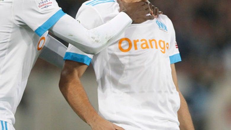 Fekir scores 2 as Lyon beats Metz 2-0 to move into 3rd place