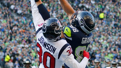 Houston Texans cornerback Kevin Johnson (30) breaks up a pass intended for Seattle Seahawks tight end Jimmy Graham, right, in the second half of an NFL football game, Sunday, Oct. 29, 2017, in Seattle. (AP Photo/Stephen Brashear)