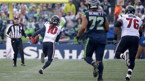 Houston Texans wide receiver DeAndre Hopkins (10) runs for a touchdown as Seattle Seahawks defensive end Michael Bennett (72) looks on in the second half of an NFL football game, Sunday, Oct. 29, 2017, in Seattle. (AP Photo/Elaine Thompson)