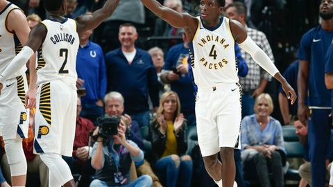 INDIANAPOLIS, IN - OCTOBER 29: Darren Collison #2  and Victor Oladipo #4 of the Indiana Pacers high five during the game against the San Antonio Spurs at Bankers Life Fieldhouse on October 29, 2017 in Indianapolis, Indiana. NOTE TO USER: User expressly acknowledges and agrees that, by downloading and or using this photograph, User is consenting to the terms and conditions of the Getty Images License Agreement.(Photo by Michael Hickey/Getty Images)