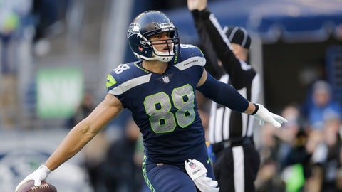 Seattle Seahawks tight end Jimmy Graham celebrates after he scored a touchdown against the Houston Texans in the second half of an NFL football game, Sunday, Oct. 29, 2017, in Seattle. It was Graham's second touchdown in the second half and the Seahawks won 41-38. (AP Photo/Stephen Brashear)