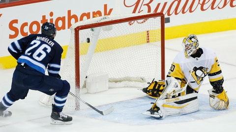 Winnipeg Jets right wing Blake Wheeler (26) scores on Pittsburgh Penguins goalie Matthew Murray (30) during the first period of an NHL hockey game in Winnipeg, Manitoba, Sunday, Oct. 29, 2017. (John Woods/The Canadian Press via AP)
