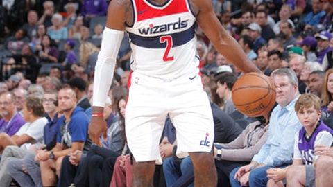 SACRAMENTO, CA - OCTOBER 29: John Wall #2 of the Washington Wizards handles the ball against the Sacramento Kings on October 29, 2017 at Golden 1 Center in Sacramento, California. NOTE TO USER: User expressly acknowledges and agrees that, by downloading and or using this photograph, User is consenting to the terms and conditions of the Getty Images Agreement. Mandatory Copyright Notice: Copyright 2017 NBAE (Photo by Rocky Widner/NBAE via Getty Images)