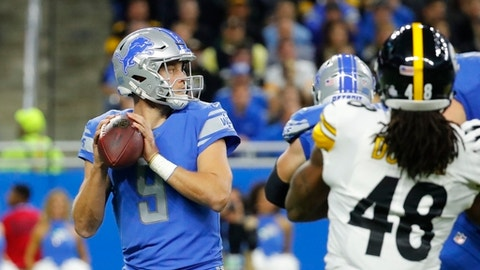 Detroit Lions quarterback Matthew Stafford (9) looks downfield during the first half of an NFL football game against the Pittsburgh Steelers, Sunday, Oct. 29 2017, in Detroit. (AP Photo/Rick Osentoski)