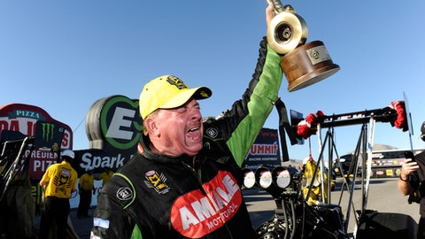 In this photo provided by the NHRA, Top Fuel veteran Terry McMillen celebrates his first career victory at the 17th annual NHRA Toyota Nationals at The Strip at Las Vegas Motor Speedway in Las Vegas, Sunday, Oct. 29, 2017. (Teresa Long/NHRA via AP)