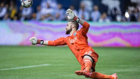 Seattle Sounders' goalkeeper Stefan Frei makes a save against the Vancouver Whitecaps during the second half of an MLS playoff soccer match in Vancouver, British Columbia, Sunday, Oct. 29, 2017. (Darryl Dyck/The Canadian Press via AP)