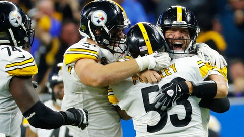 Pittsburgh Steelers quarterback Ben Roethlisberger, right, celebrates his pass to wide receiver JuJu Smith-Schuster, who then ran 97-yards for a touchdown during the second half of an NFL football game against the Detroit Lions, Sunday, Oct. 29 2017, in Detroit. (AP Photo/Rick Osentoski)