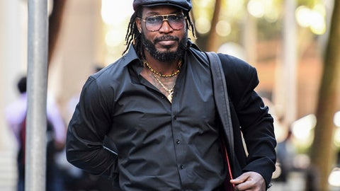 West Indies' Cricket player Chris Gayle arrives at the King Street Courts in Sydney, Australia, Monday, Oct. 30, 2017. Gayle has won his defamation case against an Australian media organization which published reports that the player indecently exposed himself to a woman in a dressing room after a practice session during the 2015 World Cup. (Brendan Esposito/AAP Image via AP)