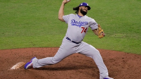 Los Angeles Dodgers relief pitcher Kenley Jansen throws during the ninth inning of Game 5 of baseball's World Series against the Houston Astros Monday, Oct. 30, 2017, in Houston. (AP Photo/Eric Gay)